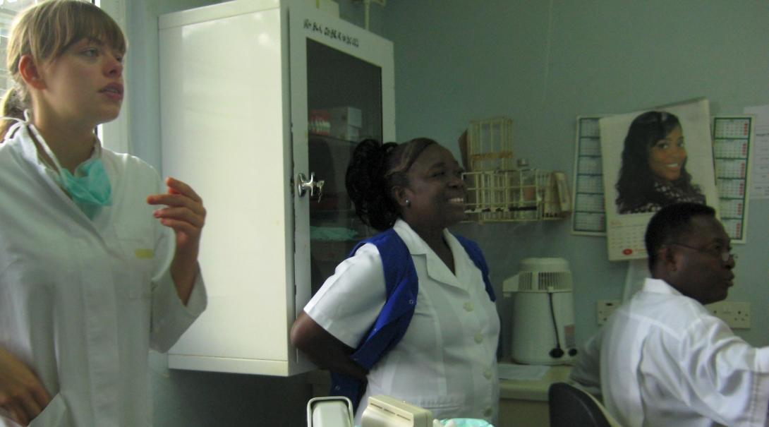 Two local dentists involve a Projects Abroad dental intern in one of their meetings at a hospital in Ghana.